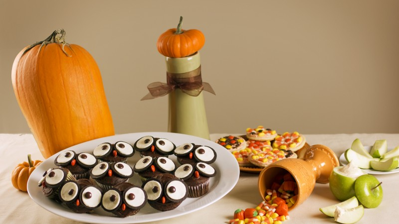Halloween, All Hallows' Eve, All Saints' Eve, holiday table, candy, muffins, apple, pumpkin (horizontal)