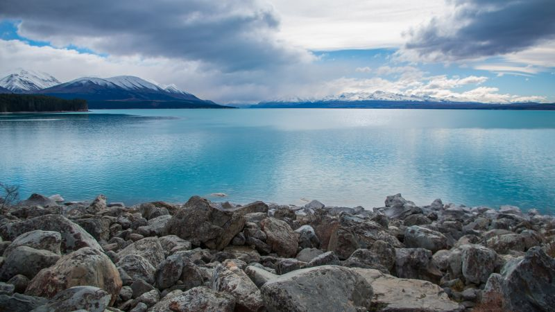Lake Pukaki, New Zealand, stones, clouds, mountains, 4k (horizontal)
