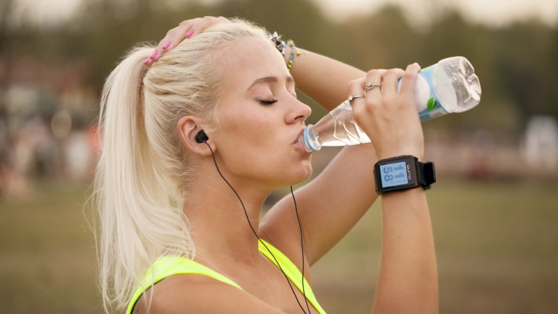 Qumo Smartwatch One, tracker, fitness bracelet, sport tracker, running girl, drinking water (horizontal)