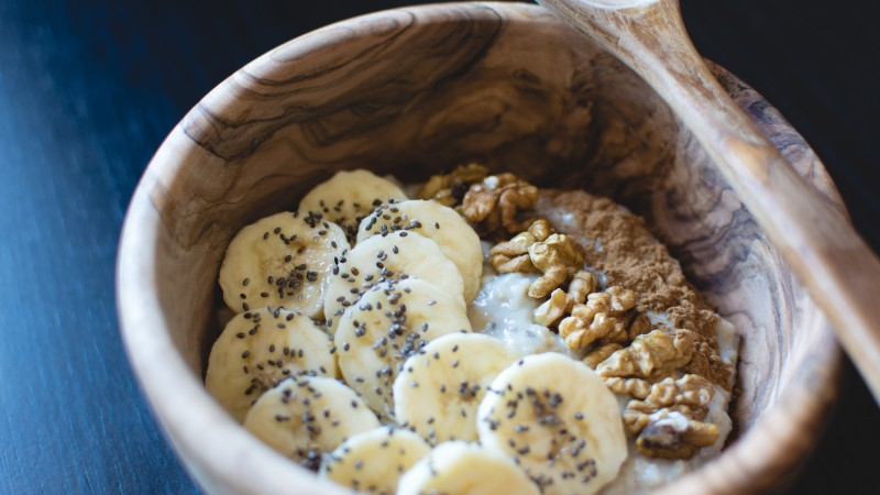 Bananas, nuts, porridge, breakfast (horizontal)