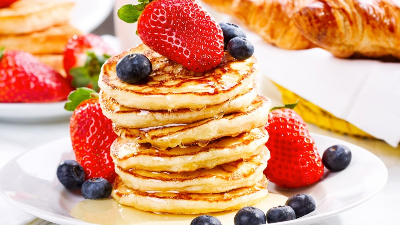 American pancakes, fruit, strawberry, blueberry, honey (horizontal)