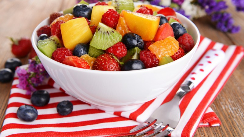 salad, fruits, raspberries, strawberries, blueberries, grapes, kiwi, mango, orange (horizontal)