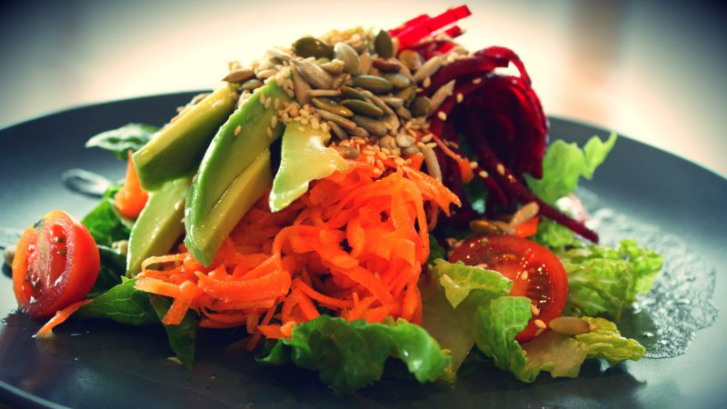 Salad, Lettuce, tomato, avocado, sesame seeds, carrots, sunflower seeds (horizontal)