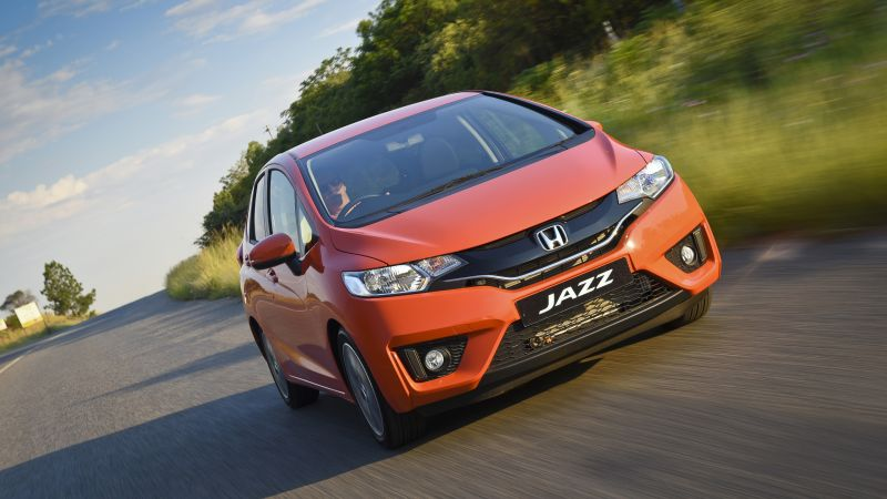 Honda jazz, hatchback, orange. (horizontal)