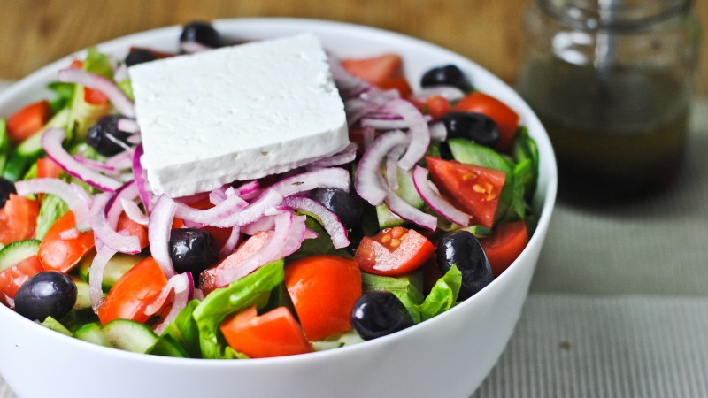 Greek, cooking, recipe, lettuce, tomatoes, cucumbers, olives, feta, onion (horizontal)