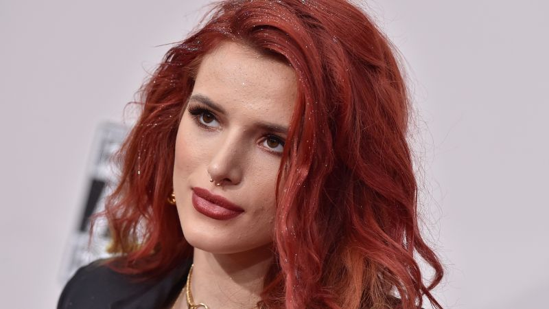 Bella Thorne, Actress, red hair, pink dress, bed, flowers, book (horizontal)