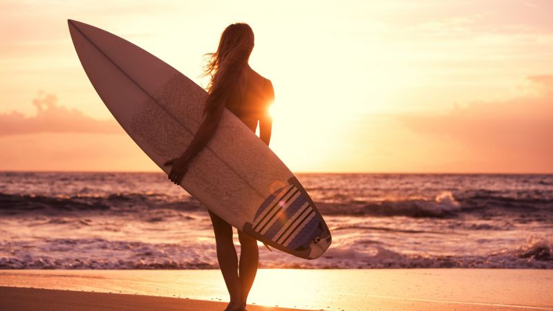 Surfing, girl, beach, sun, sea (horizontal)