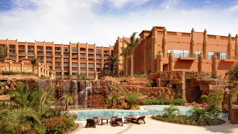 Kampala Serena, Uganda, Hotel, resort, pool, water, sunbed, waterfall, orange, travel, vacation, booking