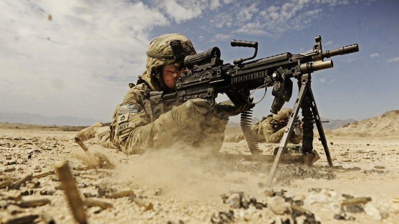 soldier, M249 LMG machine gun U.S. Army, firing, dust, sand