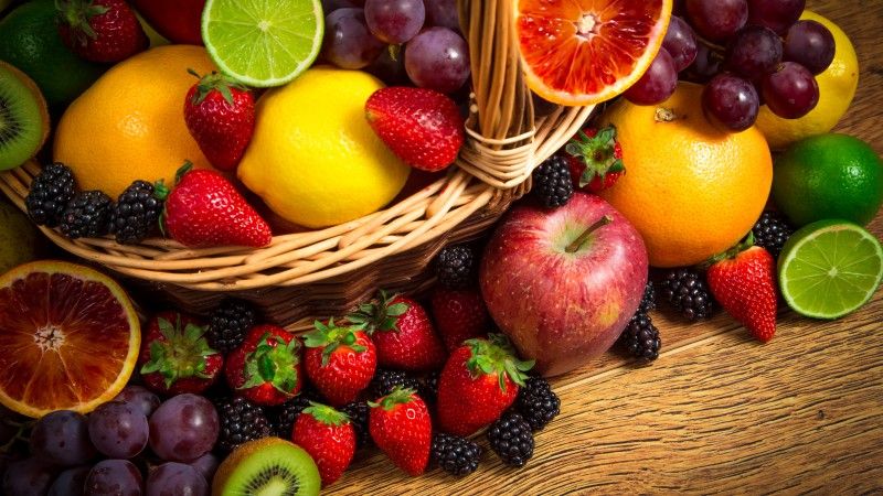 basket fruit, lemon, lime, apple, grapes, strawberries, blackberries, kiwi, grapefruit,  (horizontal)
