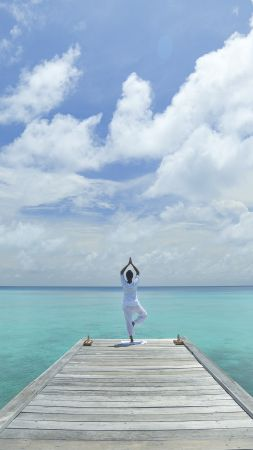Yoga, beach, sea, blue, sky (vertical)
