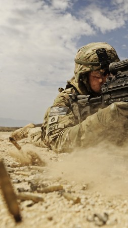 soldier, M249 LMG machine gun U.S. Army, firing, dust, sand (vertical)
