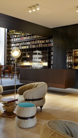 B2 Boutique Hotel and Spa, Zurich, Switzerland, Best Hotels of 2015, library, room, chair, booking (vertical)