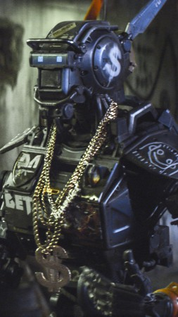 Chappie, Best Movies of 2015, robot, police, gun (vertical)