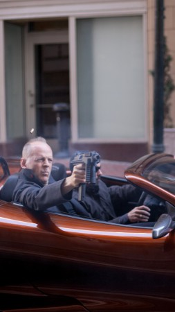 Bruce Willis, Looper, Most Popular Celebs in 2015, actor, car, gun (vertical)