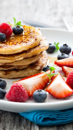 Pancakes, raspberry, fruit, strawberry, blueberry, honey (vertical)