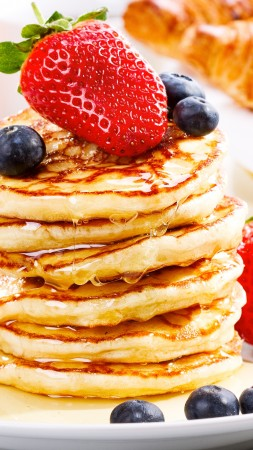 American pancakes, fruit, strawberry, blueberry, honey (vertical)
