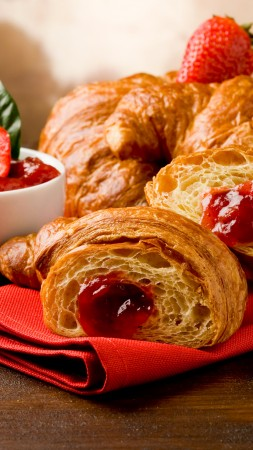 French croissants, fruit, strawberry jam (vertical)
