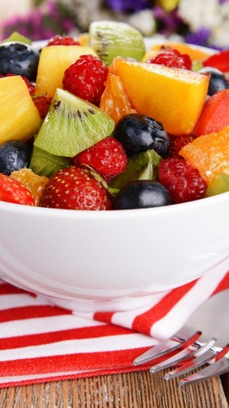 salad, fruits, raspberries, strawberries, blueberries, grapes, kiwi, mango, orange (vertical)