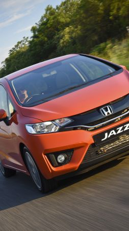 Honda jazz, hatchback, orange. (vertical)
