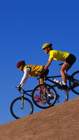 Вicycling, bicyclists, blue, sky (vertical)