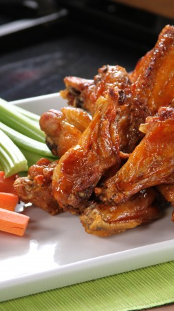Buffalo wings, sauce, vegetables, carrots (vertical)