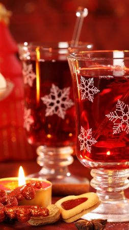 Mulled wine, candle, biscuits, cinnamon, decorations, peanuts, Christmas (vertical)
