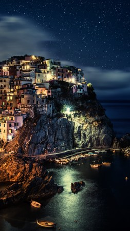 Manarola, Italy, Riomaggiore, province of La Spezia, Liguria, night, blue, water, sea, ocean, boats, sky, twilight, harbor, travel, vacation, booking (vertical)