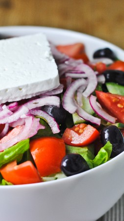 Greek, cooking, recipe, lettuce, tomatoes, cucumbers, olives, feta, onion (vertical)