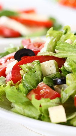 Greek, cooking, recipe, lettuce, tomatoes, cucumbers, olives, feta (vertical)