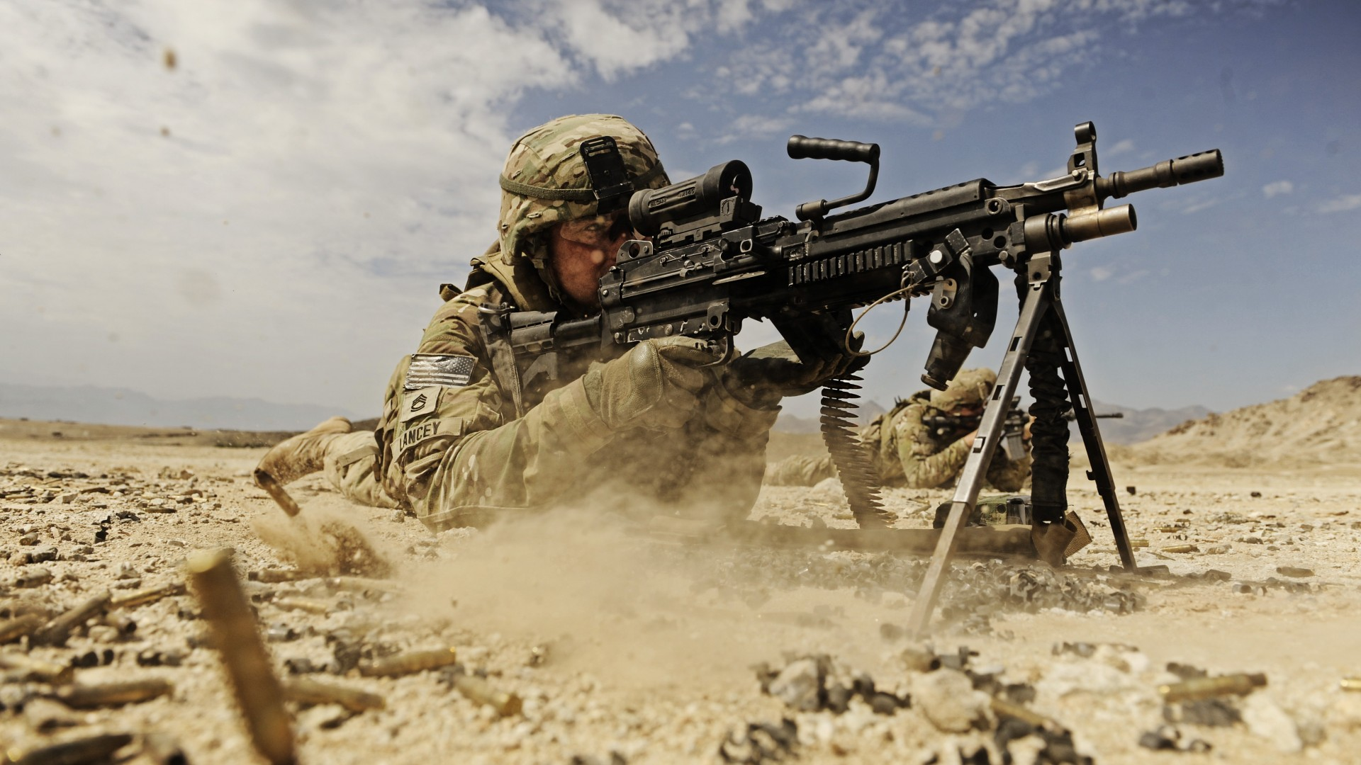 soldier, M249 LMG machine gun U.S. Army, firing, dust, sand (horizontal)
