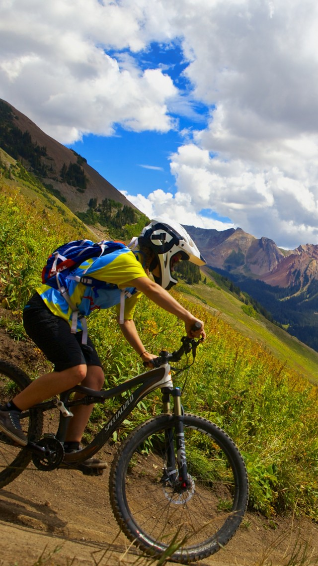 Crested butte biking, cycle racing, mount, sky, clouds (vertical)