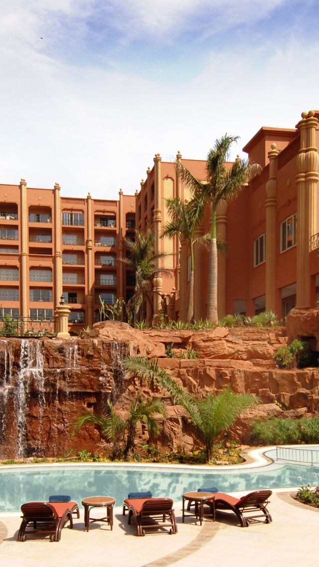 Kampala Serena, Uganda, Hotel, resort, pool, water, sunbed, waterfall, orange, travel, vacation, booking (vertical)