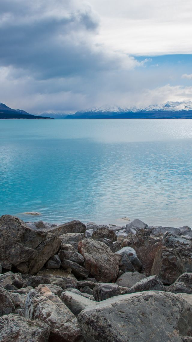 Lake Pukaki, New Zealand, stones, clouds, mountains, 4k (vertical)