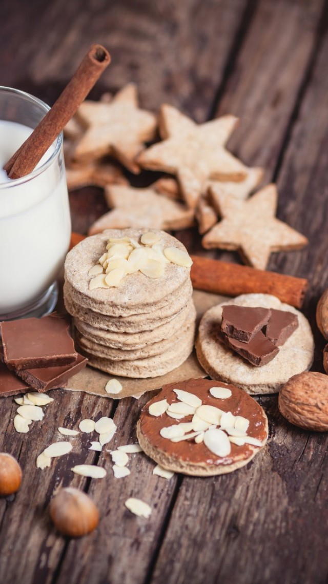milk, drinks, spices, cinnamon, nuts, walnuts, hazelnuts, almonds, chocolate, baking, figurines, cookie (vertical)