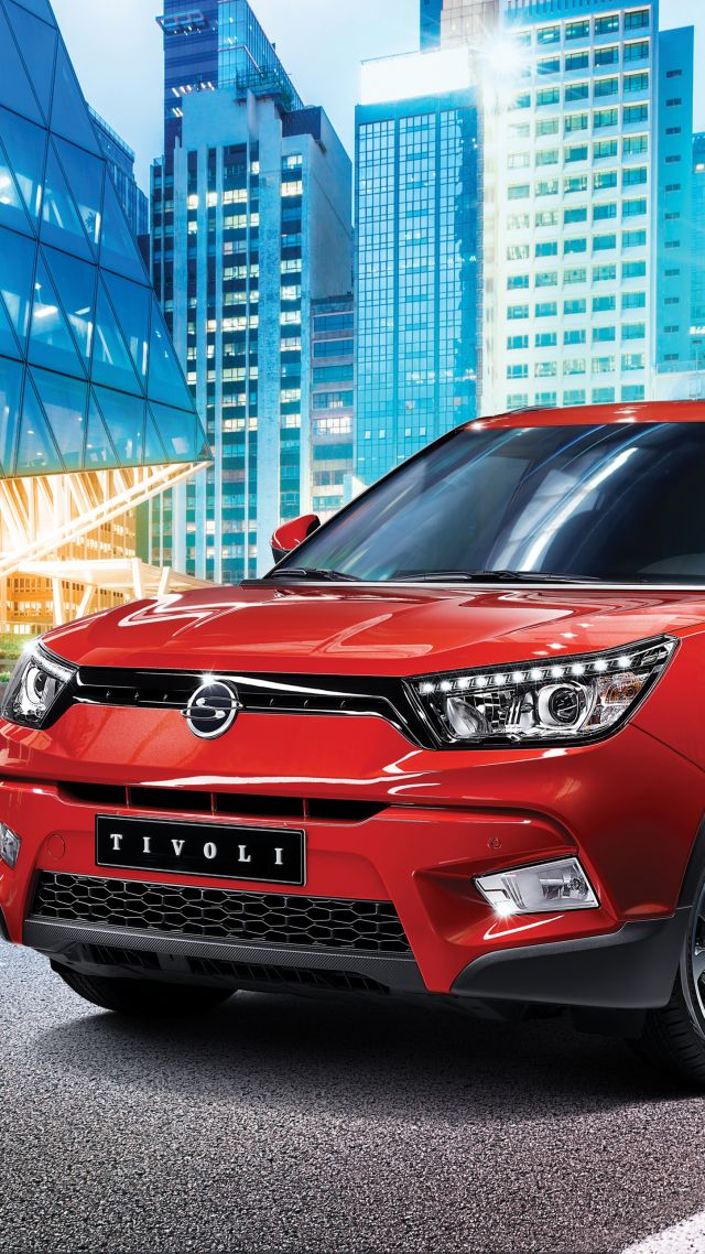 Ssangyong tivoli, crossover, red, city. (vertical)
