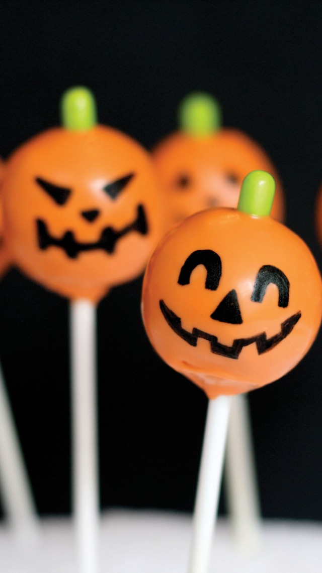 Halloween, All Hallows' Eve, All Saints' Eve, holiday table, candy, apple, pumpkin (vertical)